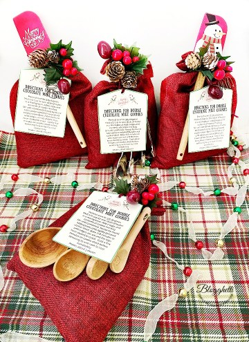Gift bags decorated for Christmas with cookie mix inside