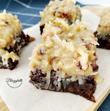 square bites of German chocolate brownies on wooden board