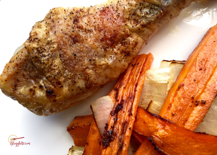 oven roasted chicken drumsticks with roasted carrots on white plate