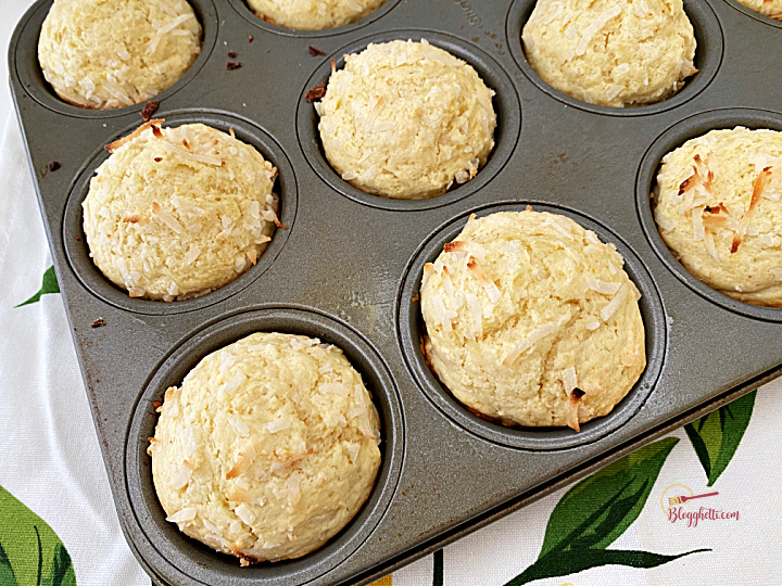 baked lemon coconut muffins in baking pan