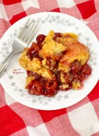 cherry cobbler served on white and gray plate