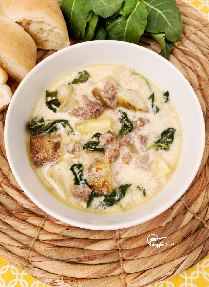 zuppa toscana soup in white bowl made in the slow cooker