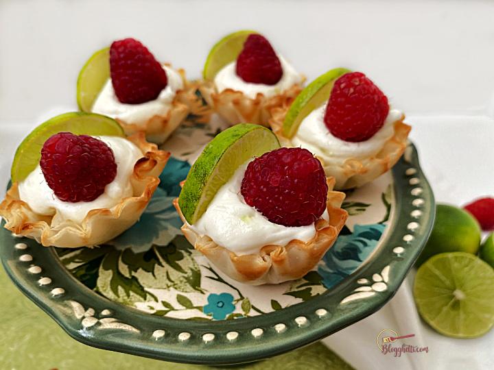 Key Lime Mini tarts on green platter