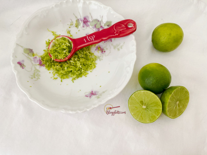 zest of key limes in white bowl with limes on the side