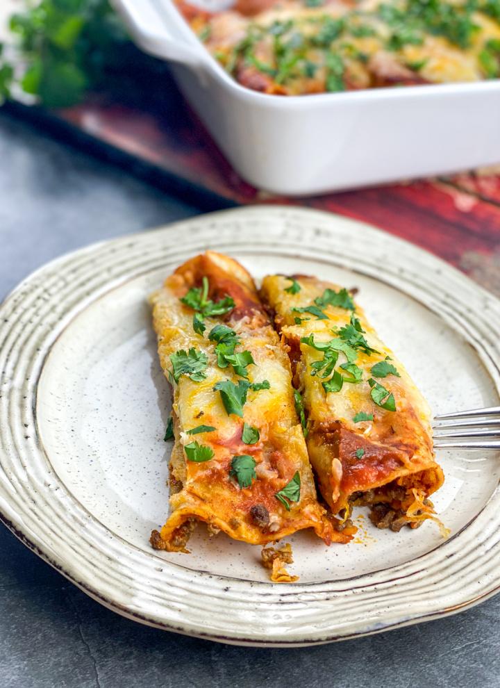 Easy Beef Enchiladas on white plate