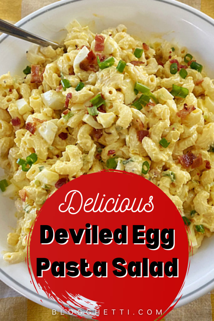 bowl of deviled egg pasta salad with a text overlay