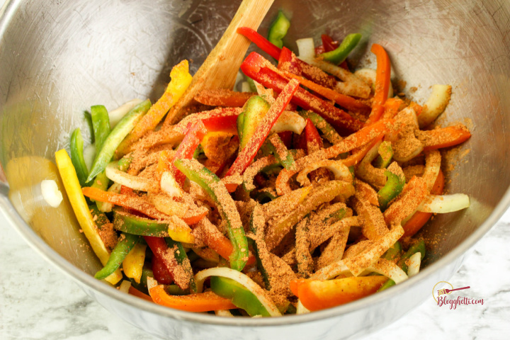 sliced vegetables with taco seasoning on them in bowl