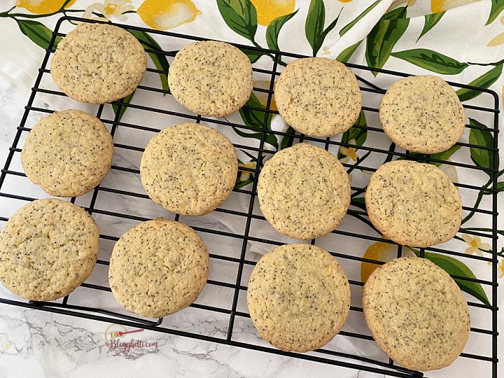 baked lemon poppy seed cookies cooking on wire rack