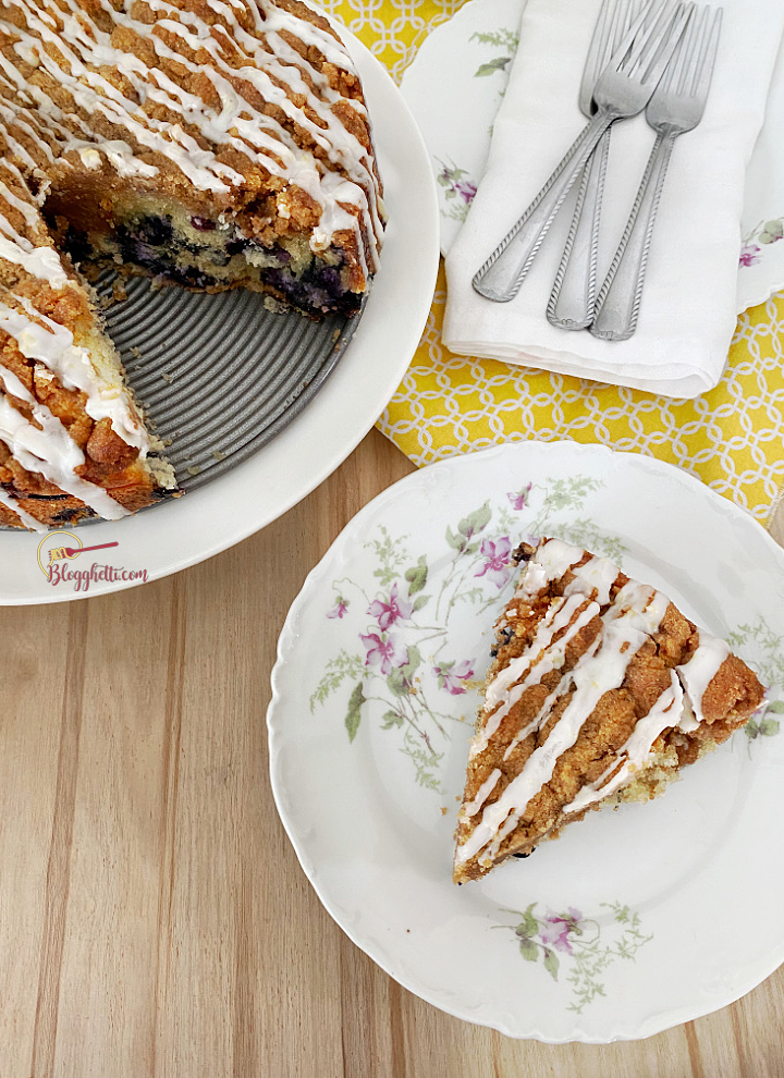 blueberry streusel cake with slice on plate
