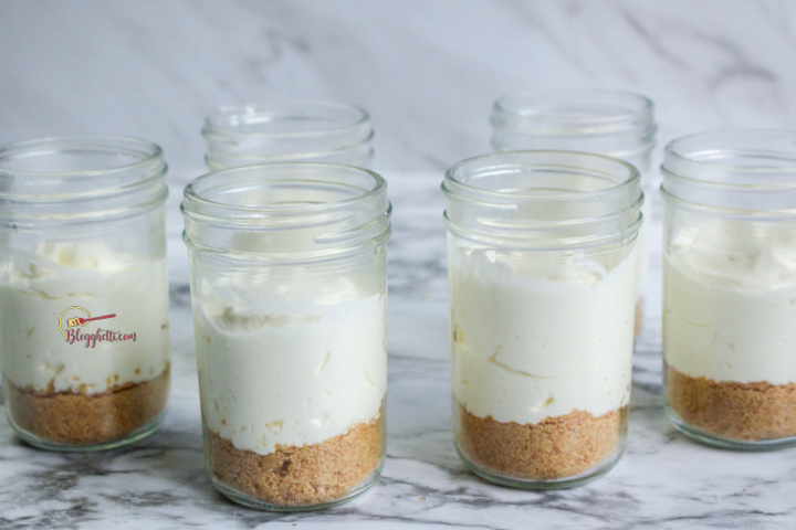 filling the jars with the cheesecake mixture