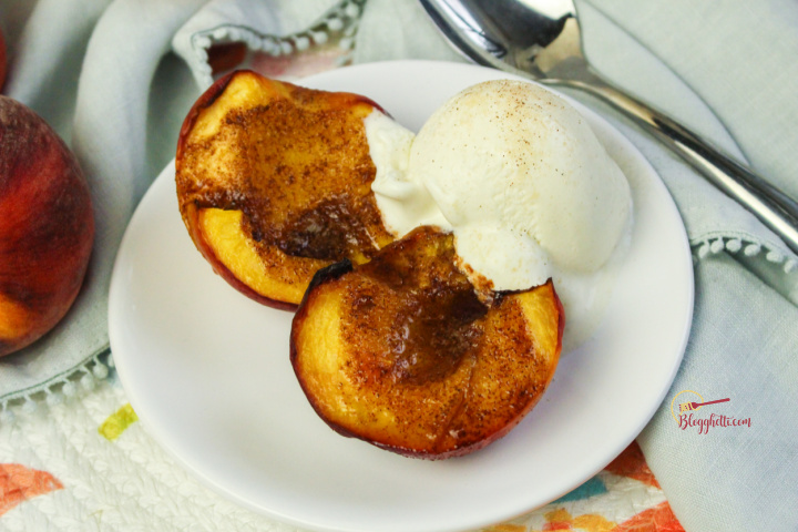 air fried peaches with ice cream on white plate
