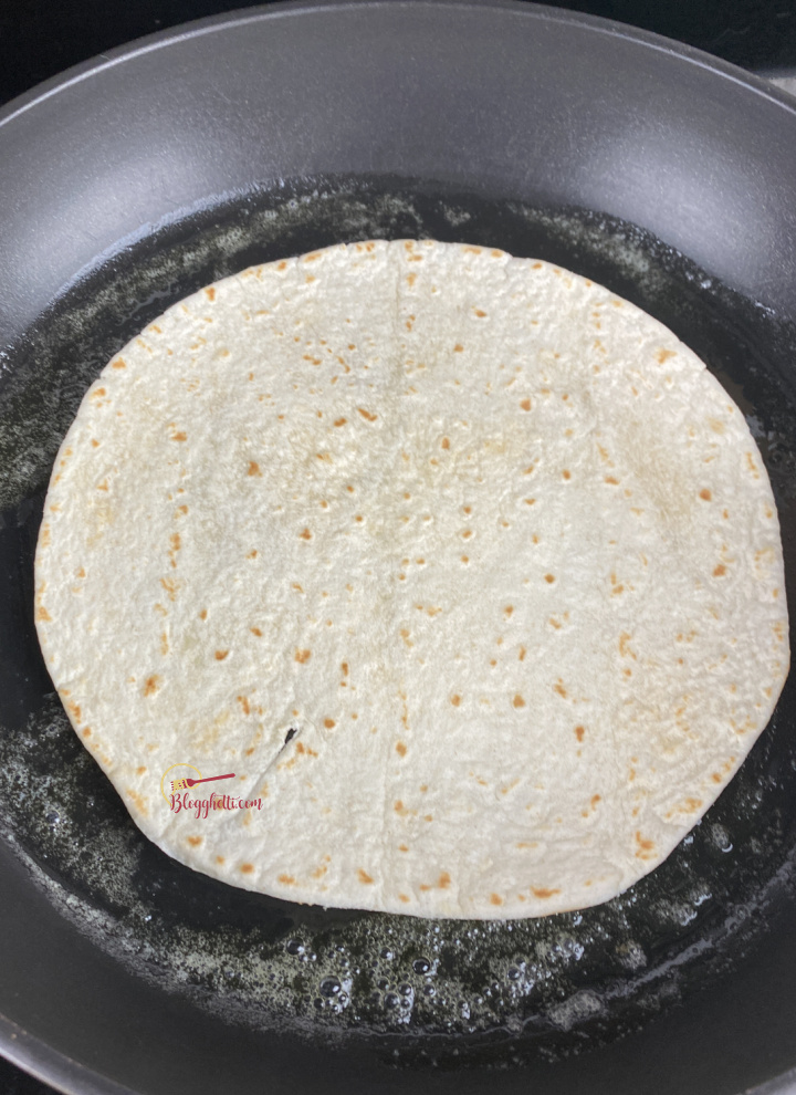 browing the flour tortilla in skillet