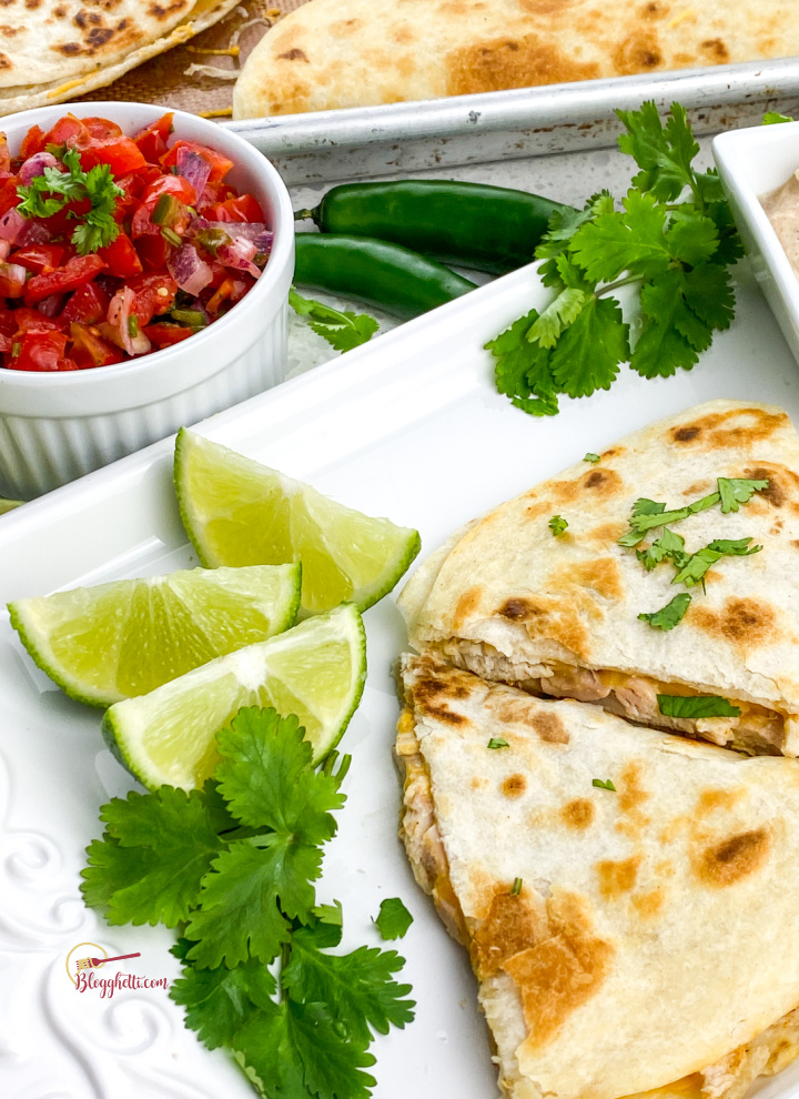 rotisserie chicken quesadilla with pico de gallo on white platter
