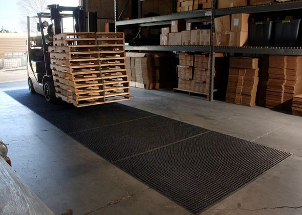 Andersen Waterhog Lift Truck Mats Supporting Movement of Pallets Across the Warehouse Floor