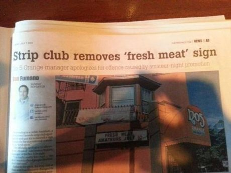"Headline: ""Strip club removes 'fresh meat' sign."""