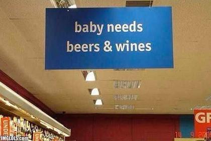 """Sign: """"Baby needs beer & wines"""""""