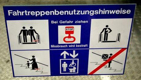 """Fahrtreppenbenutzungshinweise: Bei gefhar ziehen. Missbrauch wird bestraft!  Translation: Escalator use instructions: """"Pull in case of danger. Abuse will be punished!"""""""