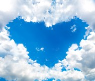 clouds forming heart shaped opening in sky