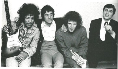 Jimi Hendrix, Cat Stevens, Gary Leeds (Walker) & Engelbert Humperdinck - Backstage at the opening night of the Walker Brothers UK Tour at Finsbury Park Astoria on 31 March 1967. Cat Stevens (holding gun). (1967)