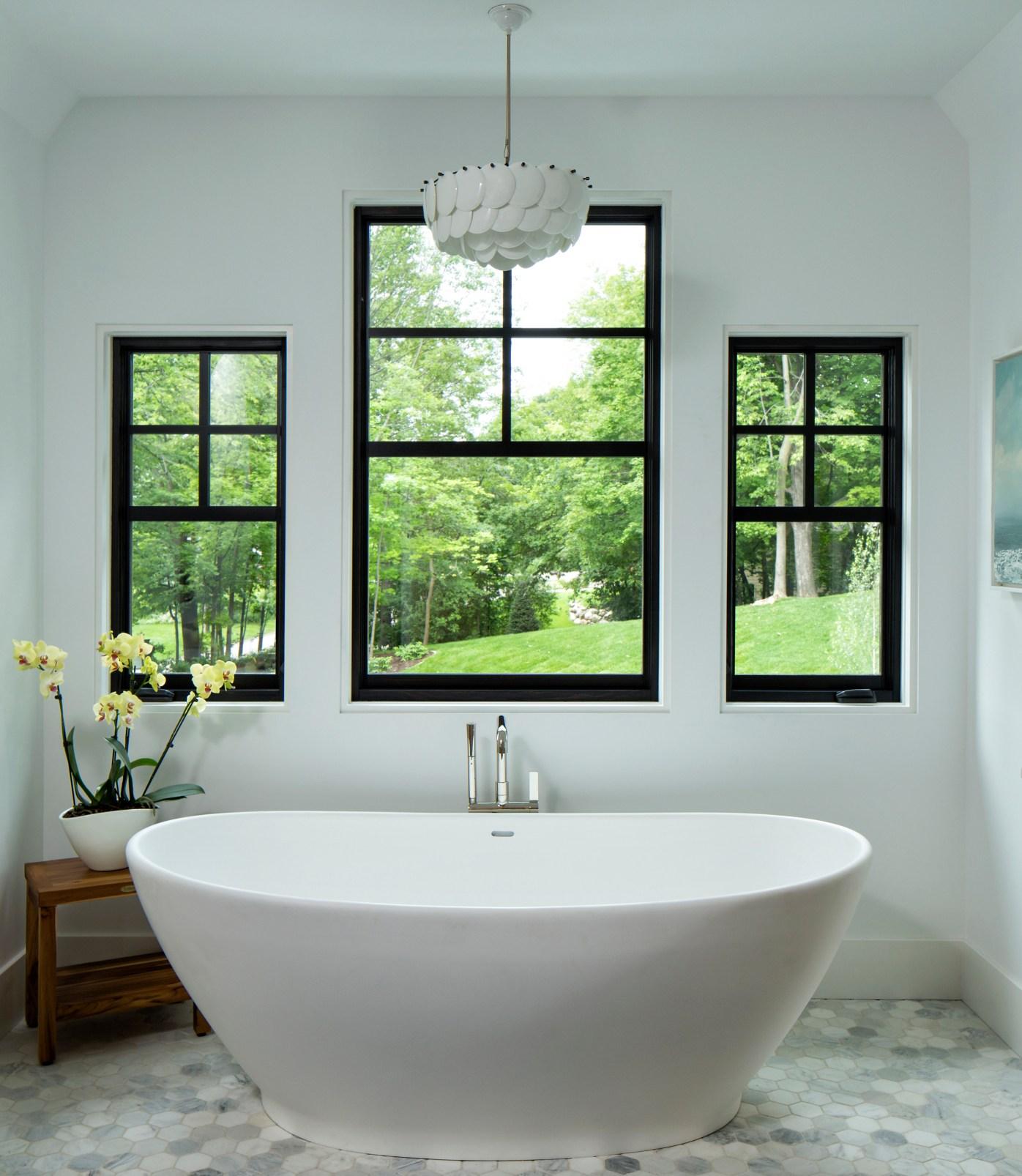 All-white bathroom with dark exterior Marvin windows