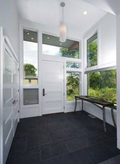 Home entryway with white doors and Integrity windows