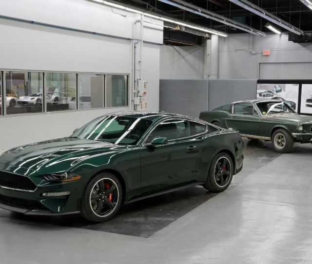 Green  Ford Mustang Bullitt Parked With A Green  Ford Mustang Gt Fastback Parked In