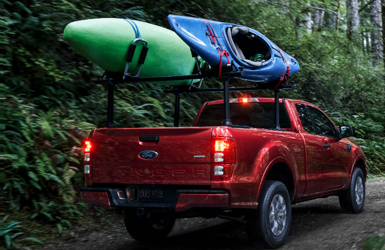 2019 ford ranger in forest with kayaks