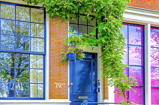 a beautiful facade with blue painted door and windows