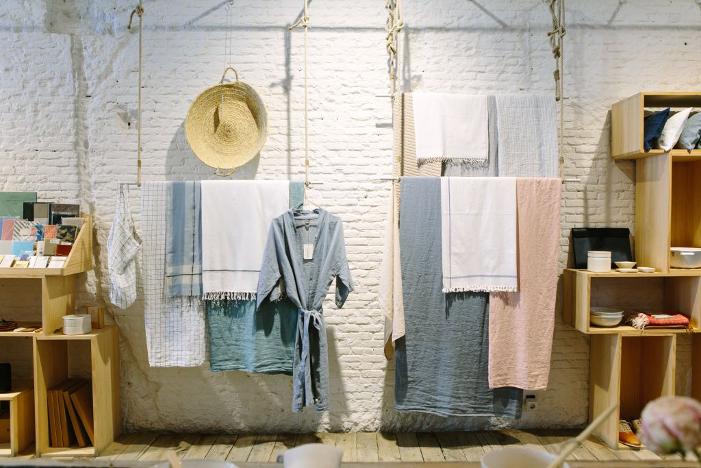 natural fabrics hanging on an indoor line