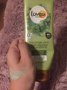 Lovea green clay mask on hand