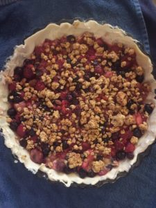 granola topping on berry tart