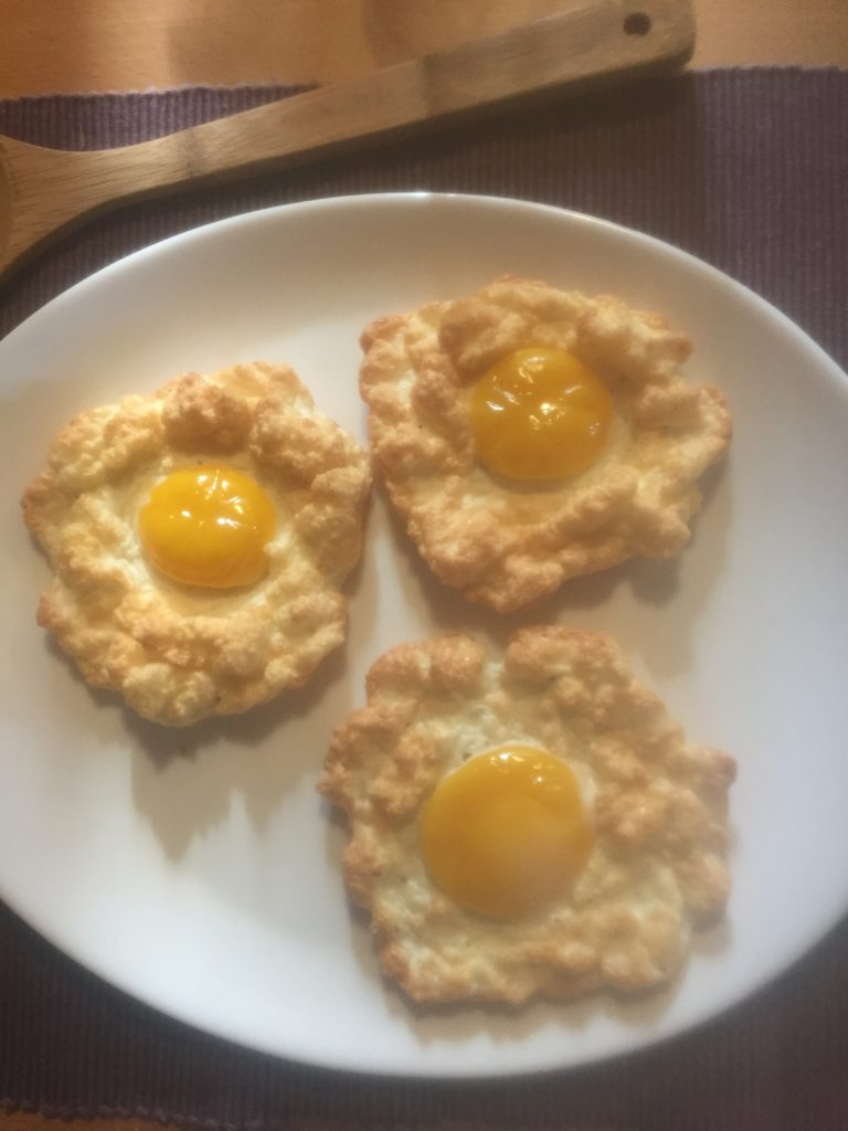 Baked fluffy egg clouds on a plate