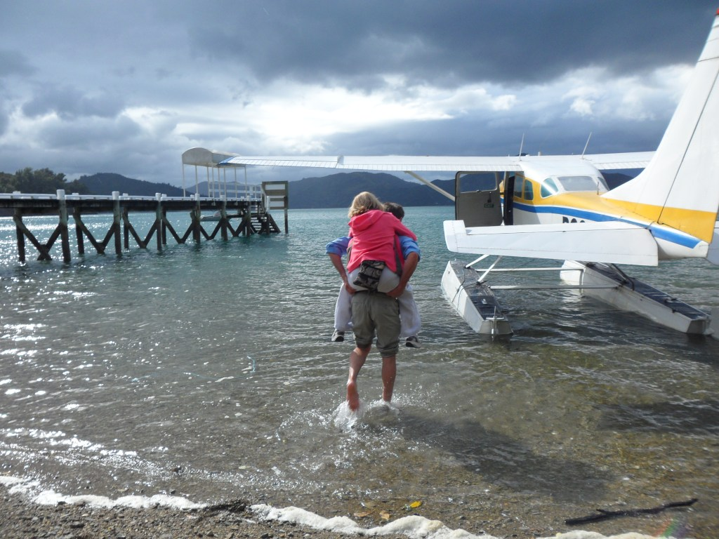 Getting carried to the float plane by the pilot!