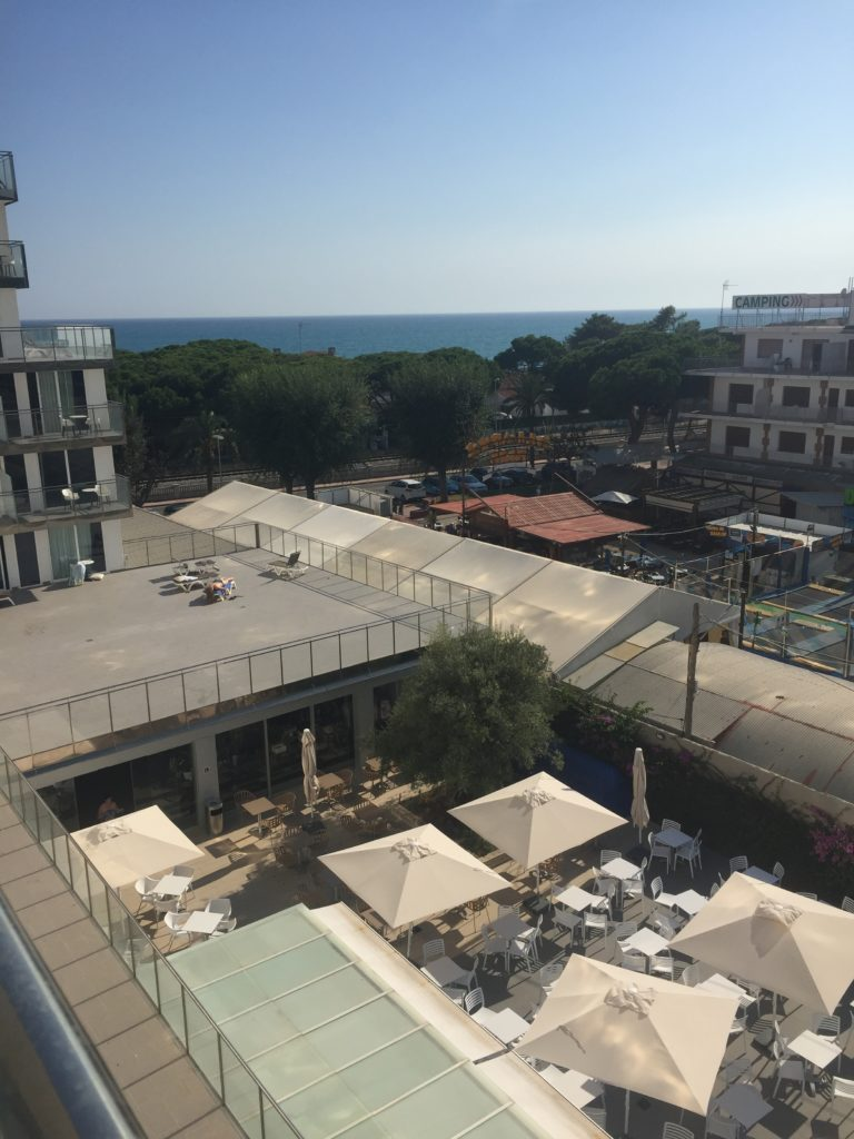 View of the sea and courtyard of Europa Splash hotel, Malgrat de Mar from hotel balcony