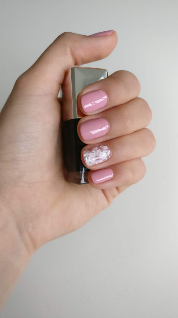 a russian manicure pink with flower