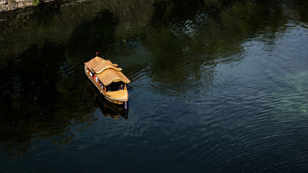 Golden boat on water Osaka Castle