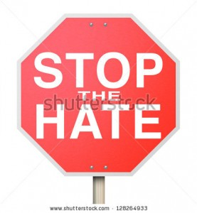 stock-photo-a-red-octogon-shapped-sign-reading-stop-the-hate-symbolizing-the-need-to-end-intolerance-racism-128264933