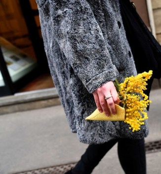 MILAN, ITALY - MARCH 08: A dettail of a woman carrying bunches of mimosa during International Women's Day Celebrations in Milan on March 8, 2017 in Milan, Italy. (Photo by Pier Marco Tacca/Getty Images)
