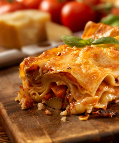Authentic Italian Vegetarian Lasagna on a Cutting Board with Ingredients -Photographed on Hasselblad H3D2-39mb Camera