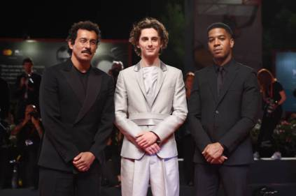 "VENICE, ITALY - SEPTEMBER 02: Haider Ackermann, Timothee Chalamet and Kid Cudi attend ""The King"" red carpet during the 76th Venice Film Festival at Sala Grande on September 02, 2019 in Venice, Italy. (Photo by Stefania D'Alessandro/WireImage,)"