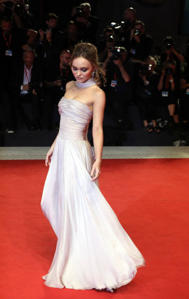 """VENICE, ITALY - SEPTEMBER 02: Lily-Rose Depp walks the red carpet ahead of the """"The King"""" screening during the 76th Venice Film Festival at Sala Grande on September 02, 2019 in Venice, Italy. (Photo by Elisabetta A. Villa/WireImage,)"""