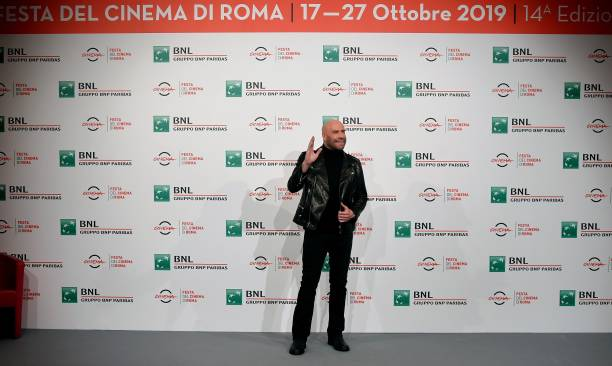 US actor John Travolta gestures during a photocall on October 22, 2019 as part of the 14th Rome Film Festival (Festa del Cinema di Roma) at the Auditorium Parco della Musica in Rome. (Photo by Tiziana FABI / AFP) (Photo by TIZIANA FABI/AFP via Getty Images)
