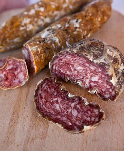 Italy, Trentino Alto Adige, Taio . Mortandela and Lucanica di Capra traditional Sausages at Luca Malench butcher store.
