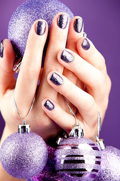 Beautiful woman's hand holding christmas bals
