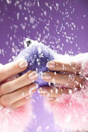 Woman's hands holding christmas ball