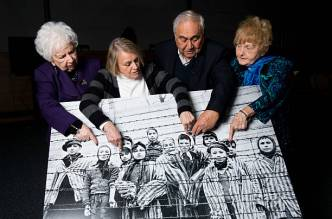 KRAKOW, POLAND - JANUARY 26: (L-R) 79-year-old Miriam Ziegler, 81-year-old Paula Lebovics, 85-year-old Gabor Hirsch and 80-year-old Eva Kor pose with the original image of them as children taken at Auschwitz at the time of its liberation on January 26, 2015 in Krakow, Poland. This week marks the 70th anniversary of the liberation of Auschwitz and to mark the event USC Shoah Foundation have brought together, for the first time, four of the survivors from the iconic image by Alexander Vorontsov of Auschwitz children. Auschwitz was among the most notorious of the extermination camps run by the Nazis to enslave and kill millions of Jews, political opponents, prisoners of war, homosexuals and Roma. (Photo by Ian Gavan/Getty Images)