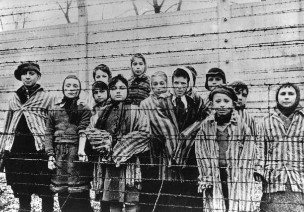 Survivor children in the concentration camp Auschwitz-Birkenau after the liberation. 1945. Poland. Photograph. February 1945. (Photo by Votava/Imagno/Getty Images) .