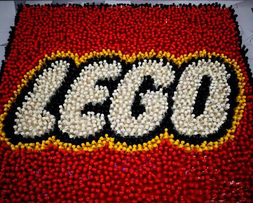 A Lego logo is pictured during the annual New York Toy Fair, at the Jacob K. Javits Convention Center on February 16, 2019 in New York City. (Photo by Johannes EISELE / AFP) (Photo credit should read JOHANNES EISELE/AFP via Getty Images)