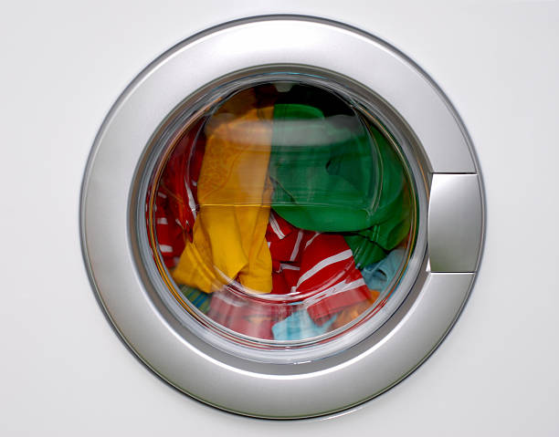 washing machine - filled with colorful laundry