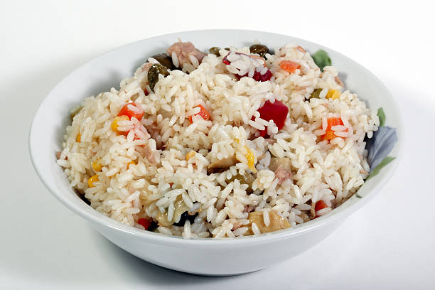 Rice salad with tuna fish  and several vegetable toppings